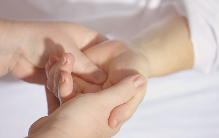 Massaging hand in therapy
